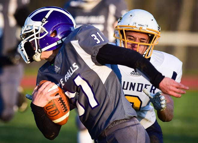 Little Falls Mountie Tyler Stowell (31) runs down the field after making a catch as Central Valley Academy defender Anderson Klosner attempts to make a tackle Friday. Stowell scored the the game's winning touchdown on a reception in the final minute of the fourth quarter.