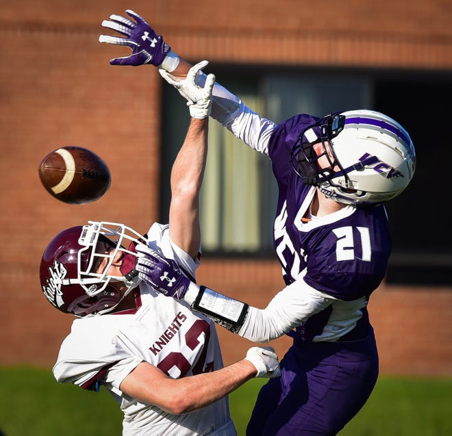 Frankfort-Schuyler Maroon Knight Angelo DeBrango and West Canada Valley Indian Andrew Soron (from left) jump for the ball during Friday's game.