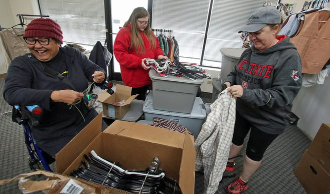 Tina Marshall, Rory Ditz and Christine Hailey help put out clothing  at Totally Free Clothes Store Saturday afternoon, April 24, 2021, on South Lafayette Street in Shelby.