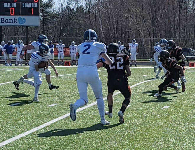 Lunenburg's Troy Drasser rushes for a score in a game last year against Gardner.