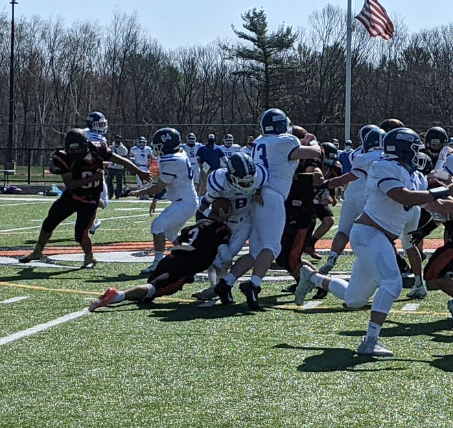 Gardner's Noah Martins (3) tackles Lunenburg quarterback Adam Hill at the line of scrimmage for no gain during Saturday's game at Watkins Field in Gardner.