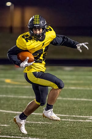 Galesburg sophomore Cameron Aguirre looks for running room during the Silver Streaks' 23-20 loss to WB6 foe Alleman on Friday, April 23, 2021 at Van Dyke Field.