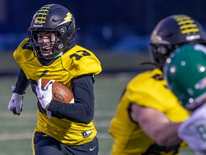Galesburg junior wide receiver Dre Egipciaco , left, eyes daylight as he turns a reception into a touchdown during the Silver Streaks 23-20 WB6 Conference loss to Alleman on Friday, April 23, 2021 at Van Dyke Field.