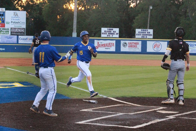 East Ascension's Jordan Goodlow scores during the Spartans' 6-2 victory over St. Amant.
