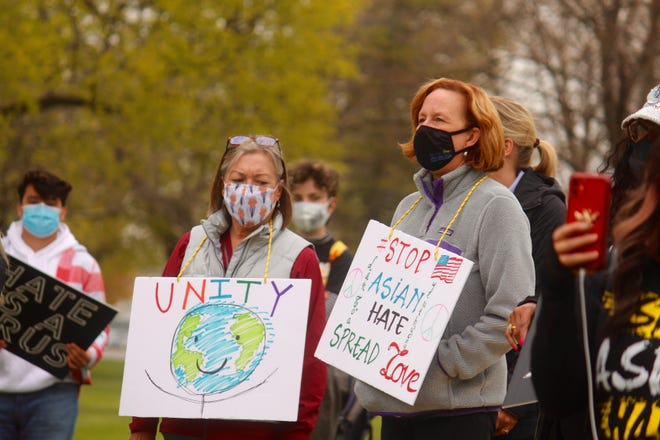 Members of the greater-Holland community participated in a Rally Against Hate at Kollen Park on Saturday, April 24, 2021, in Holland, Mich.