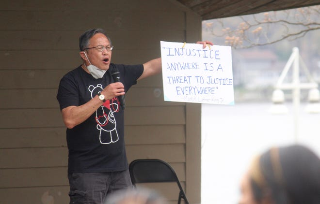 Johnny Liu speaks during the Rally Against Hate at Kollen Park on Saturday, April 24, 2021, in Holland, Mich.