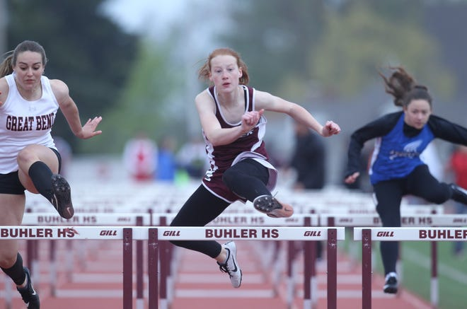 Buhler's Caylin Seely runs the 100 meter hurdles during prelims at the Buhler Invitational.