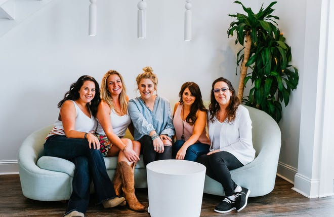 """From left to right - Jennifer Vanek, Beth Jones, Katie Rochelle, Marilyn Didomenico, and Jeanette Georgitis. All of them are business owners in Sneads Ferry and are promoting """"community over competition"""" in order to support other women-owned businesses."""