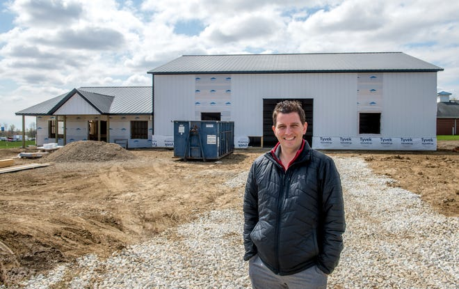 Nate Heinold of Ledgestone Insurance is building a new office with an attached warehouse to store the disc golf equipment for the Ledgestone Insurance Open, an annual disc golf tournament held at several area courses that attracts hundreds of disc golfers from around the country.