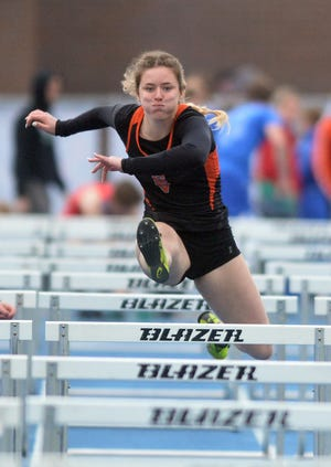 Belle Peters of Smoky Valley won the 100-meter high hurdles, pole vault, 200-meter dash and long jump at the 50th Conrad Nightingale Invitational.