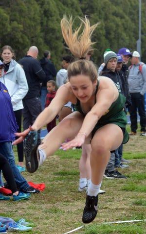 Jaelynn Bridges of Pratt competes in the triple jump in the 50th Conrad Nightingale Invitational.