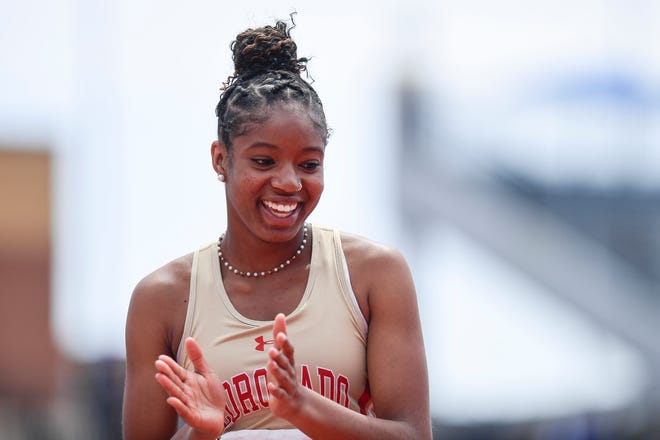 Coronado's Bryanna Craig reacts to clearing the high jump at the Region I-4A and 5A track and field meet April 23 at PlainsCapital Park at Lowrey Field.
