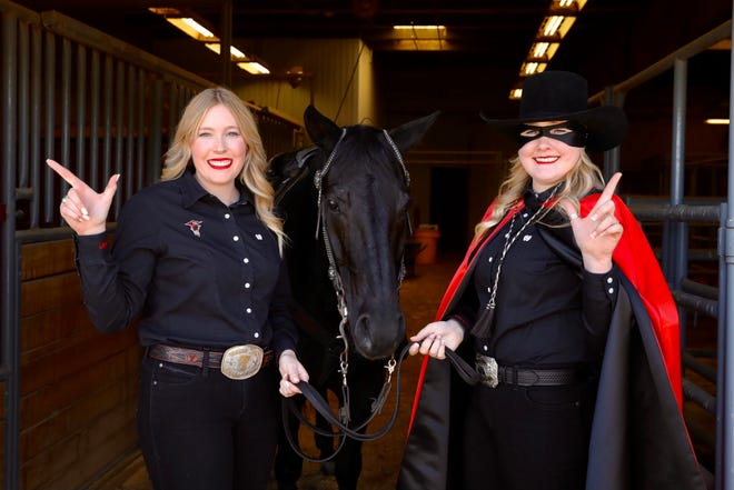 Cameron Hekkert, the 59th Masked Rider, transfers the reins to Ashley Adams.