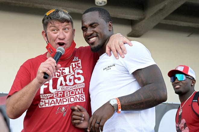 Tampa Bay Buccaneers general manager Jason Licht, left, address the audience with linebackers Lavonte David, center, and Devin White during a celebration of their Super Bowl 55 victory over the Kansas City Chiefs in Tampa in February. When Jason Licht declared he was going to do everything he could to keep the Tampa Bay Buccaneers together, no one envisioned the process going as smoothly as it has for the Super Bowl champions.