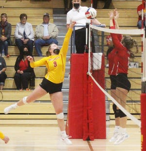 Rocky Ford High School's Gracie Moreland puts the ball over two McClave defenders in Saturday's match at the Melon Dome. The Meloneers won in four sets.