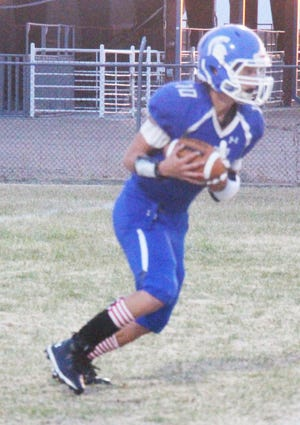 Las Animas High School's Justin Miller receives a kickoff in Friday's game at Jack LaSalle Trojan Field. The Trojans lost to top-ranked Hoehne 58-0.