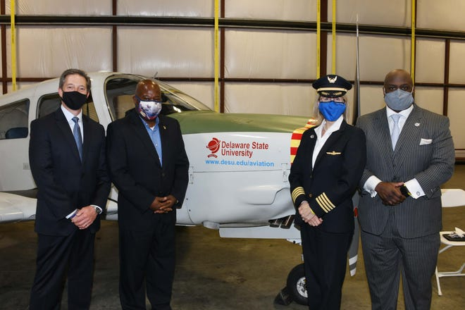 Delaware State University Aviation graduates will have a direct path to becoming a pilot with a major airline through a new affiliated partnership between the institution and United Airlines. From left, Tom Horne, Delaware market president, JP Morgan Chase, who connected DSU with United Airlines; Lt. Col. (retired) Michael Hales, director of the DSU Aviation Program; Mary Ann Schaffer, United Airlines systems chief pilot; and DSU President Tony Allen gather for a photo after the event.