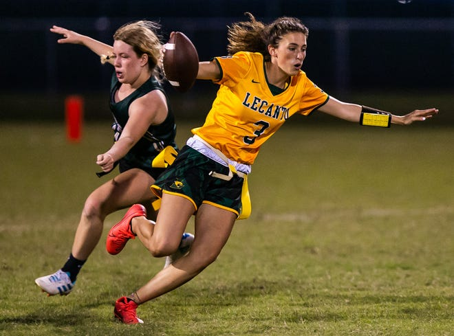 Lecanto's Jordan Martynoski eludes a Trinity Catholic player in the second half. The Lecanto High School Panthers defeated the Trinity Catholic Celtics, 27-6, in the District 1A-9 Flag Football District Finals on Friday.