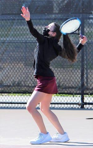 Portsmouth High School freshman Sophia Jundi delivers a serve during her No. 2 singles match on Friday against Salem. Jundi won 8-0.