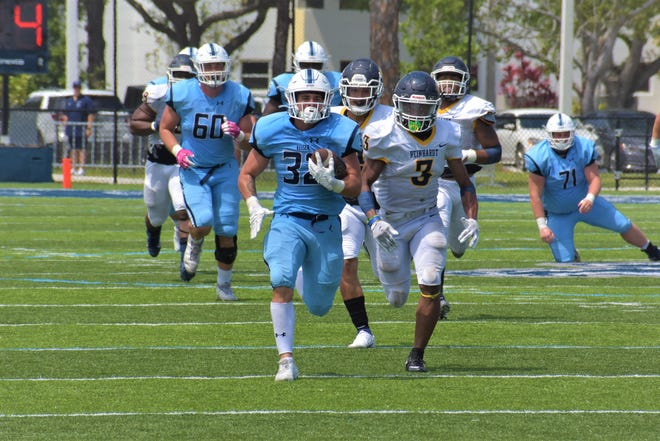 Keiser running back Jaden Meizinger breaks out for a long run in the fourth quarter, helping Keiser put the game out of reach in the NAIA quarterfinals. He finished with 173 yards on 27 carries as the Seahawks beat Reinhardt 42-14 on Saturday in West Palm Beach.