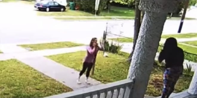 In this image captured from the phone video, the Chesterfield Food Bank worker and the resident can be seen arguing in the resident's front yard on Lynchburg Avenue in Colonial Heights Friday, April 23, 2021. In a Facebook post, CFB said it let the worker go after seeing the video.