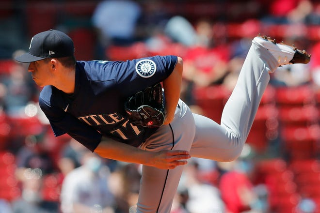 Seattle Mariners' Chris Flexen pitches against the Boston Red Sox during the first inning of a baseball game, Saturday, April 24, 2021, in Boston. (AP Photo/Michael Dwyer) ORG XMIT: NYOTK