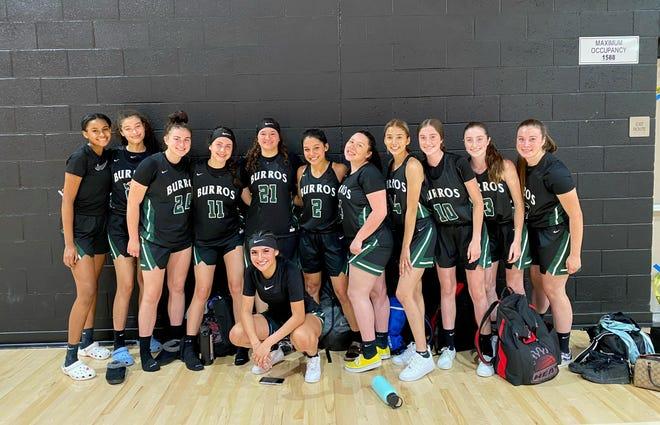 The Burroughs High School girls basketball team poses after Thursday night's win over Oak Hills.