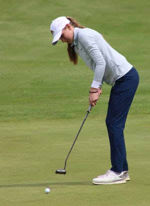 Kent State's Emily Price rolls a putt on Friday at the MAC Championships, held at Silver Lake Country Club.