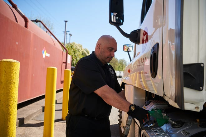 Frank Lemos, operations manager for Portland-based Titan Freight Systems, fills up a rig with renewable diesel, a biofuel made by refining vegetable oils, livestock tallow and cooking grease instead of crude oil.