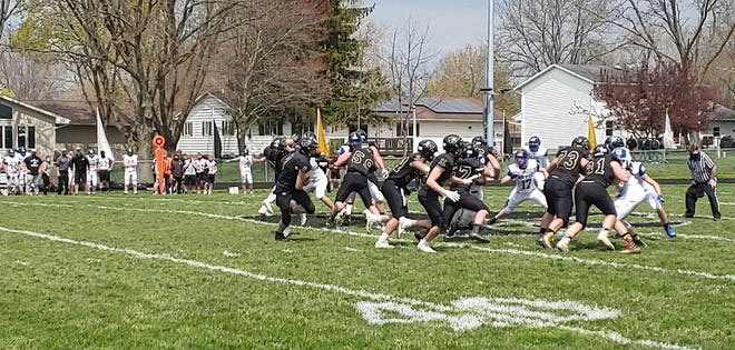 Durand/Pecatonica holds Lena-Winslow to a small gain on a running play Saturday. Le-Win won 24-21 to win the NJUIC North title.