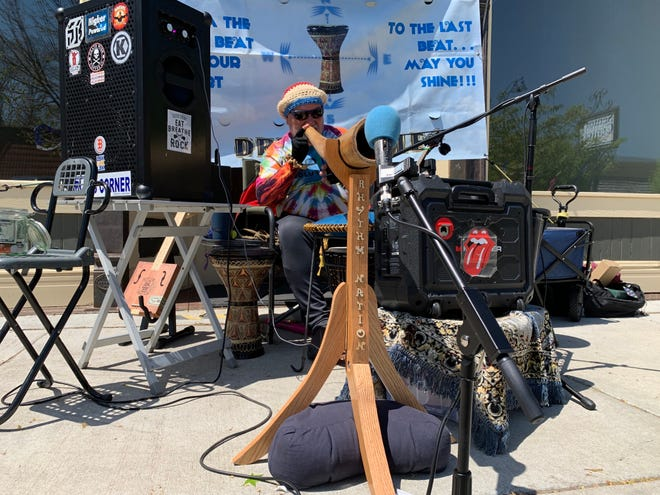 Ray Prieba, from Newton, plays the didgeridoo while performing in his one-man Rhythm Nation Drum Circle during the Lindsborg in Bloom festival Saturday, Apr. 24.
