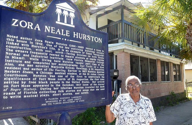 In this 2013 file photo, Johnnie Pasco stands in front of her home at 791 W. King St. where author Zora Neale Hurston once rented a second-story room.