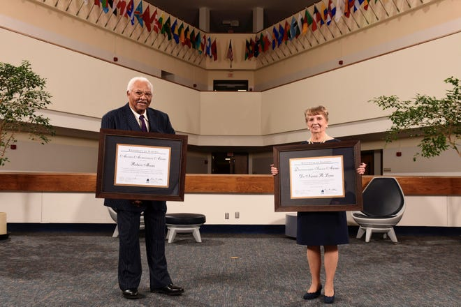 Retired U.S. Marshal Robert Moore, left, was presented the 2021 Alumni Achievement Awardfor outstanding success and national or international distinction in one's business, profession or life's work while retired University of Illinois Springfield chancellor Naomi Lynn, right, was presented the 2021 Distinguished Service Awardfor extraordinary commitment, dedication and service to the advancement of the University of Illinois during a virtual service marking the 50th anniversary of UIS. [University of Illinois Springfield]