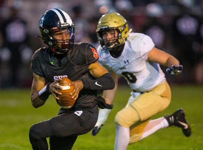 Springfield quarterback Rashad Rochelle (8) is flushed out of the pocket by Sacred Heart-Griffin's Peyton Fay (8) in the first half at Memorial Stadium in Springfield, Ill., Friday, April 23, 2021. [Justin L. Fowler/The State Journal-Register]