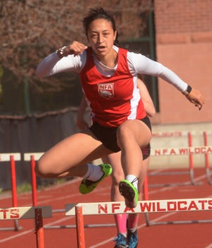 NFA's Jaelyn Callicutt wins the 300 meter hurdles Friday during a meet with East Lyme in Norwich.