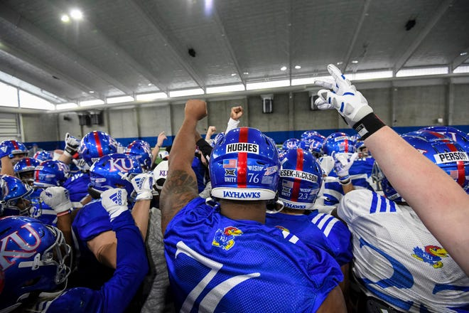 Kansas football players huddle up during a practice last Tuesday at the team's indoor practice facility in Lawrence. The Jayhawks' spring game is set for 6 p.m. May 1 at David Booth Kansas Memorial Stadium.