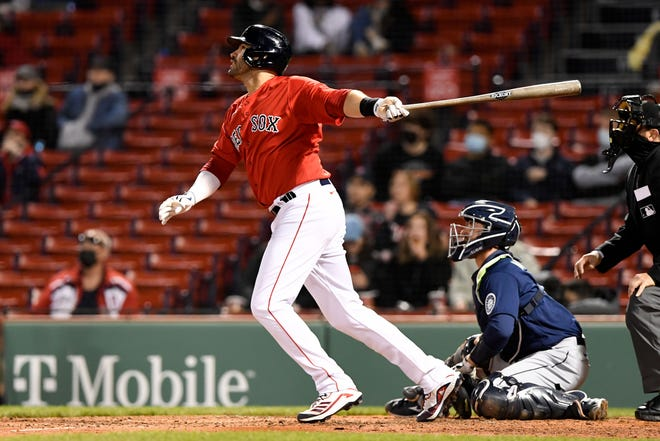 Boston's J.D. Martinez watches his third-inning home run go over the wall in right field Friday night against the Mariners.