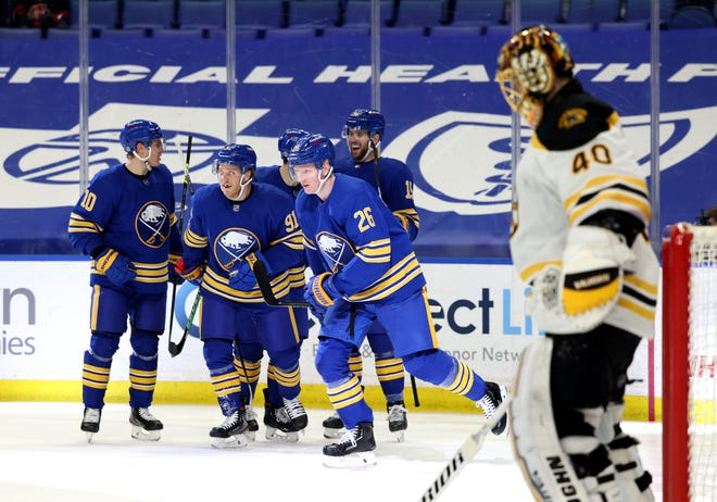 Sabres defenseman Rasmus Dahlin (26) celebrates his second-period goal with teammates against the Bruins on Friday night.