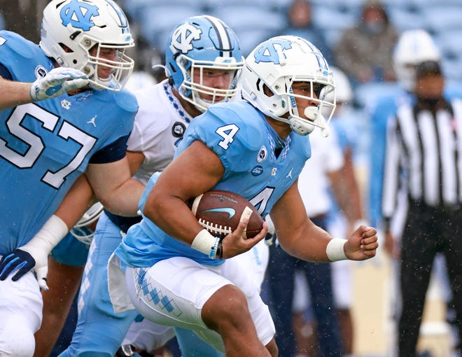 Freshman running back Caleb Hood (4) had eight carries for 33 yards, including two runs of 12 yards, in UNC football's spring game Saturday in Kenan Stadium.