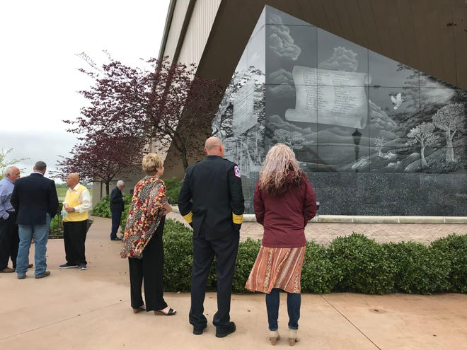 Community members and families viewed the memorial to victims of the April 27, 2011, tornado the caused 35 deaths in DeKalb County Saturday, before going inside the DeKalb County Schools Coliseum for a ceremony to mark the 10-year anniversary of the storm.