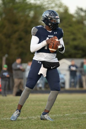 Western Alamance quarterback Kendall McKoy looks for an open receiver.