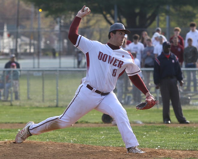 Dover starting pitcher Brennan McCune throws a pitch in Friday's game with New Philadelphia at Dover City Park. Dover won 5-0.