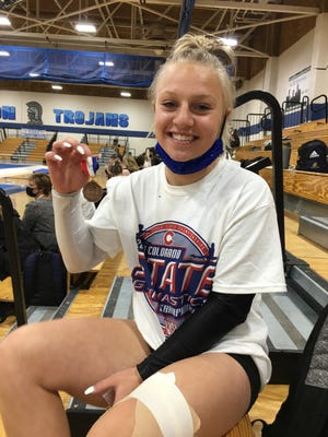 Central High School co-op gymnast Hailey Soares shows off her fourth-place medal after competing on the balance beam at the Class 4A state gymnastics meet at Thornton High School on Saturday. [Courtesy photo/Amanda Rodriguez]