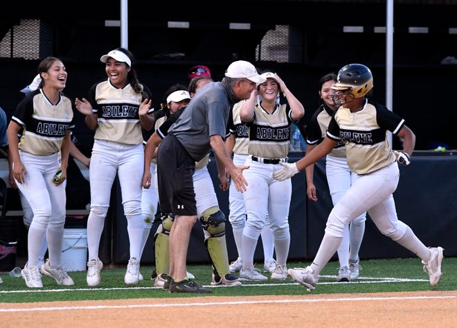 Abilene High's Amyah Starks is congratulated by coach Jim Reese after hitting a two-run home run against San Angelo Central on Friday in Abilene.