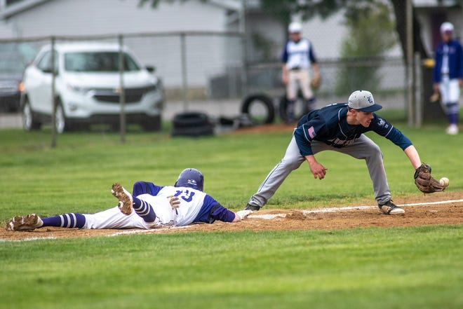 Lakeview's Jake Kucharczyk (13) slides back to third base before Lakewood's Andy Wolverton (24) can force him out on Saturday, April 24, 2021 at Lakeview High School in Battle Creek, Mich.