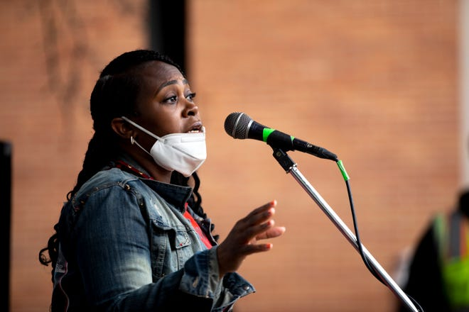 Anternitia O'Neal speaks during a rally held by the Cincinnati Anti-Police Brutality Coalition in April at New Prospect Baptist Church in Roselawn. The group is having a rally June 3, after O'Neal says an employee at a Colerain Township Walmart racially profiled her and accused her of stealing in May.