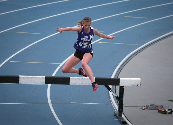 Iowa Wesleyan freshman Allison Morris clears a hurdle in the women's 3,000-meter steeplechase during the Drake Relays on Saturday, April 24, 2021, at Drake Stadium in Des Moines.