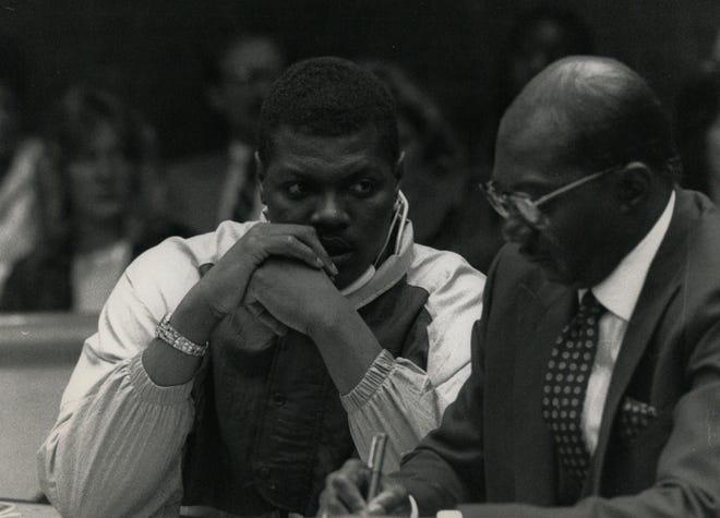 Lions defensive lineman Reggie Rogers speaks with his lawyer in court on Dec. 15, 1988.