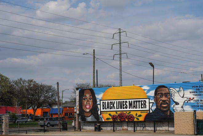 A mural in memory of Breonna Taylor and George Floyd is seen in a parking lot at the corner of East 8 Mile Road and John R Street in Detroit on Friday, April 23, 2021.