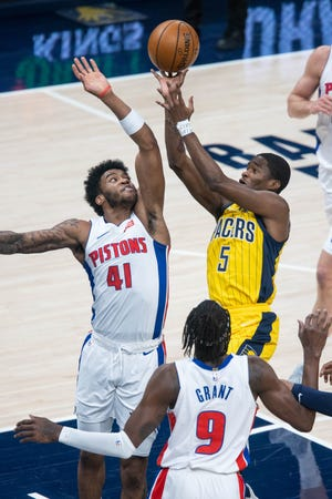 Indiana Pacers guard Edmond Sumner (5) shoots the ball while Detroit Pistons forward Saddiq Bey (41) defends in the first quarter on April 24, 2021 at Bankers Life Fieldhouse.